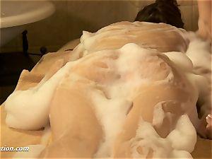 Rita Ulyanova being showered and her labia frigged