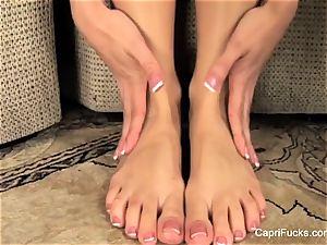 uber-sexy Capri Cavanni plays with her uber-cute soles