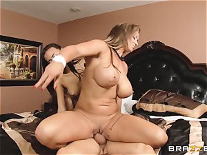 Eva Notty displays her stepdaughter Janice Griffith how to satisfy a stiffy